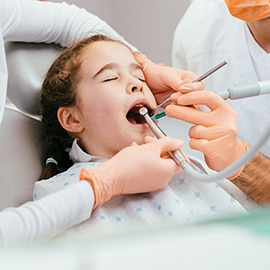 Young girl resting in dental chair