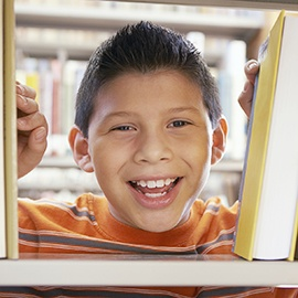 Smiling boy at the library