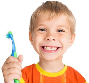 a boy holding a toothbrush
