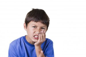 little boy with mouth pain