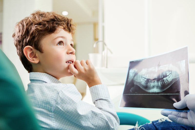 Child viewing X-ray at dental appointment