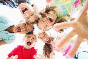 circle of kids smiling