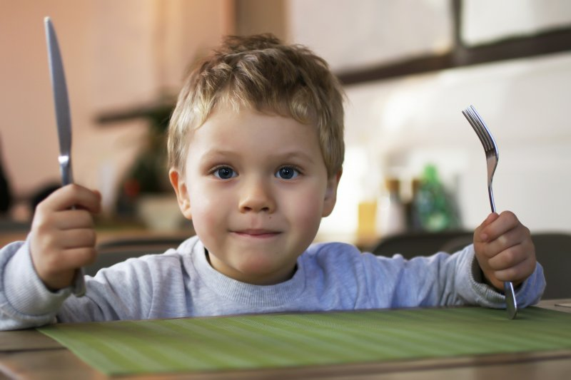 Child with fork and knife