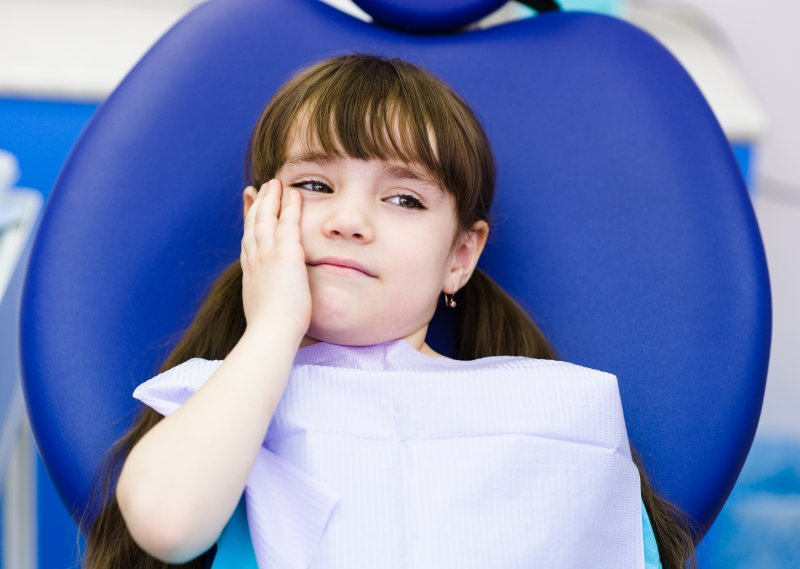 Child at dentist for tooth extraction